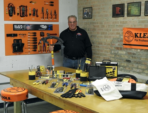 Klein Tools 2016 Electrician of the Year runner-up, Bill Budz, displays his tool donation to the HVAC Technical Institute in Chicago.