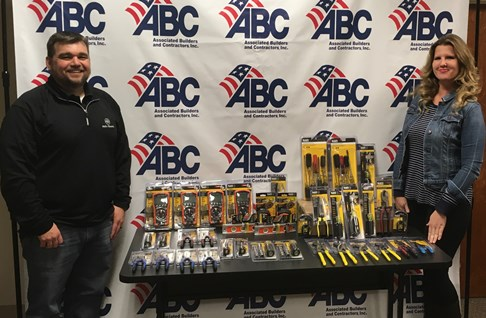 Vice President of Education for ABC, Kara Arenas, receives tool donation from Klein Tools 2016 Electrician of the Year, Eric Simmons.